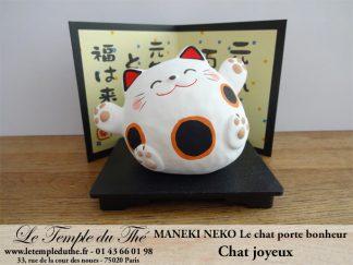 Maneki-Neko Le chat porte bonheur joyeux