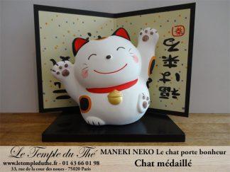 Maneki-Neko Le chat porte bonheur médaillé