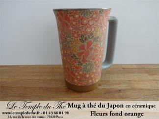 Long mug à thé du Japon en céramique 35 cl fleurs fond orange